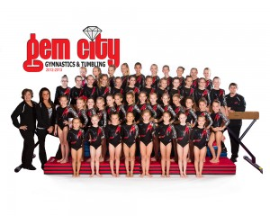 Coaches Kiki Backoff, Hope Cernea, and Jacob Huff are picture with the entire 2012-2013 gymnastics team.