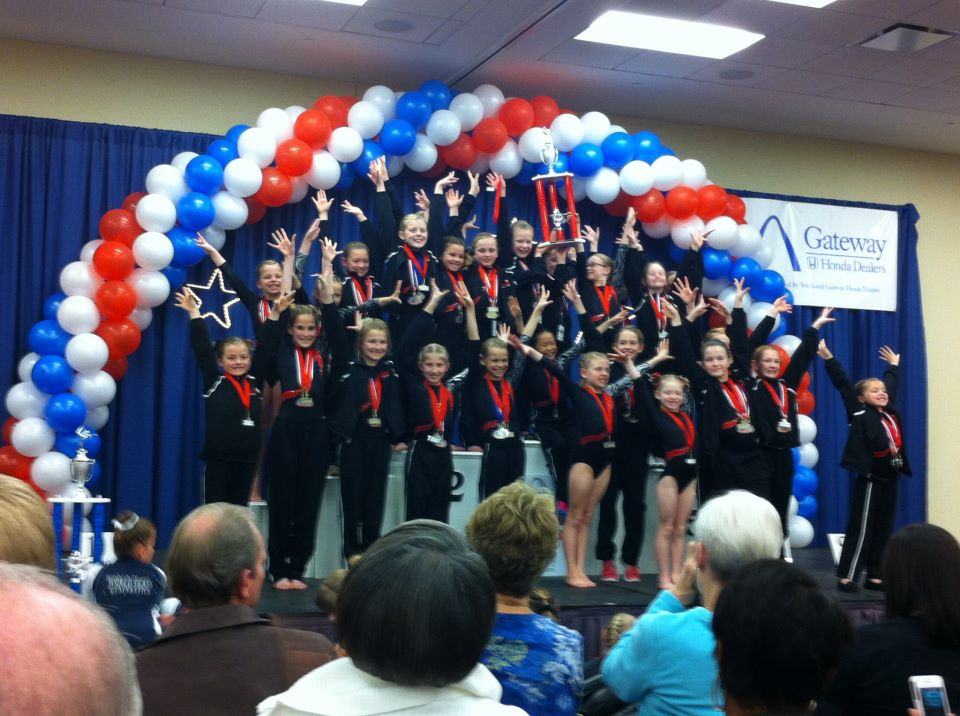 Gem City's level 4 gymnastics team receives their trophy at the St. Louis Classic meet. | Photo by Cinda Barnes