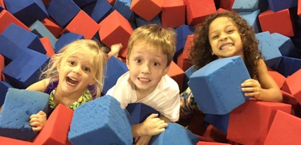 Children play in the foam pit