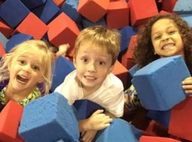 Children play in the foam pit