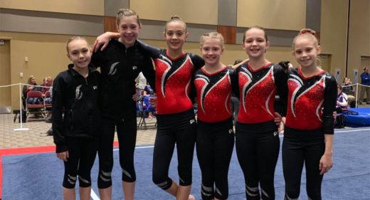 Athletes Sophia, Sophia, Alaina, Lila, Ashlyn, and Sofia pose for a picture before competition.