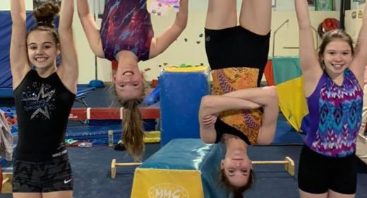 Gymnasts hanging upside down